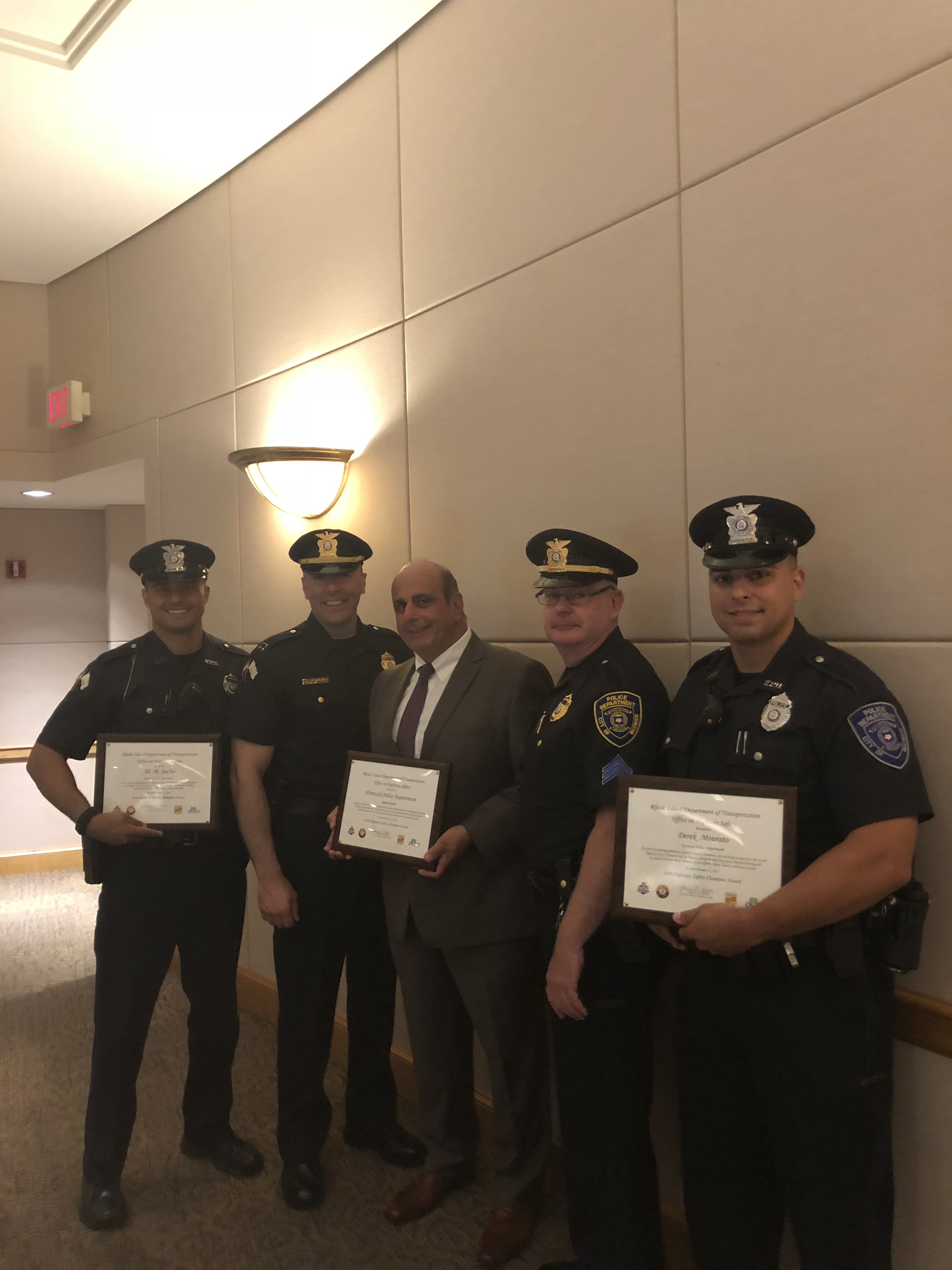 Warwick Police Department, and officers are honored with